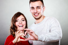 Young couple making heart shape by hands Stock Photos