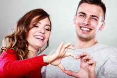 Young couple making heart shape by hands Royalty Free Stock Images