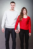 Young couple making heart shape by hands Stock Photography