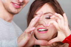 Young couple making heart shape by hands Stock Photo