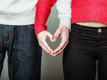 Young couple making heart shape by hands Royalty Free Stock Photography
