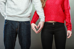 Young couple making heart shape by hands Stock Images