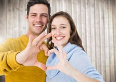 Young couple making a heart symbol with hands royalty free stock photo