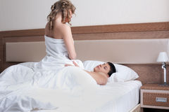 Young couple making love in bed Stock Images
