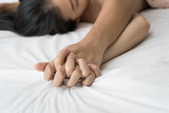Young couple making love in bed focus on hand Royalty Free Stock Photos