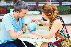 Young couple making plans for their next travel destination Stock Image