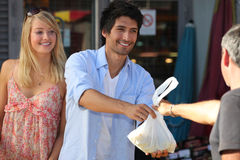 Young couple making purchases Stock Photography