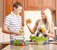 Young Couple Making Salad Royalty Free Stock Photos