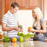 Young Couple Making Salad Stock Images