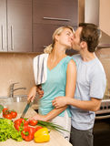 Young couple making salad Royalty Free Stock Image