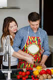 Young couple making a salad together in the kitchen Stock Photo