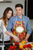 Young couple making a salad together in the kitchen Royalty Free Stock Photo