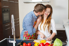 Young couple making a salad together in the kitchen Stock Photography