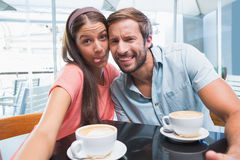Young couple making selfie with weird faces Royalty Free Stock Photos