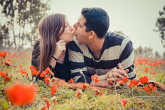 Young couple making silly faces to each other while they laying Royalty Free Stock Image
