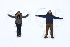 Young couple making snow angel royalty free stock images