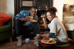 Young couple making toast on open fire Stock Images