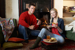 Young couple making toast on open fire royalty free stock image
