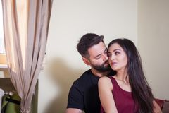 Young couple, male embracing the woman and smiling at the camera Royalty Free Stock Image