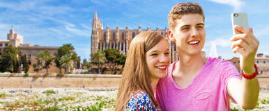 Young couple on Mallorca. Standing in front of the Cathedral La Seu Stock Photo