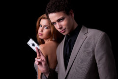 Young couple, man holding a ace of spades Royalty Free Stock Image