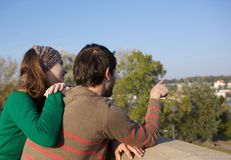 Young couple with man pointing finger Stock Image