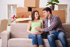 The young couple of man and pregnant wife expecting baby Royalty Free Stock Photography