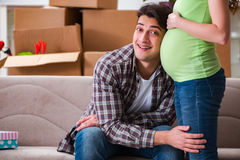 The young couple of man and pregnant wife expecting baby Stock Images