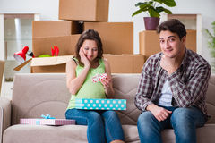 The young couple of man and pregnant wife with giftbox. Young couple of men and pregnant wife with giftbox Stock Photography