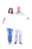 Young couple man and woman with the blank white banner. royalty free stock photos