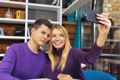 Young couple man and woman doing selfie Stock Photo