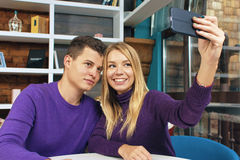 Young couple man and woman doing selfie Stock Photography