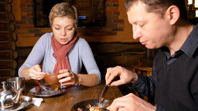 Young couple man and woman eating pizza in a cafe Stock Photo
