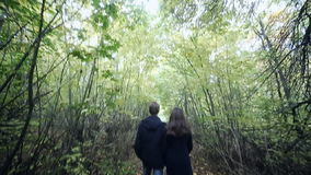 Young Couple Man and Woman Hugging in Love Romantic Outdoor with forest nature on background Fashion trendy style. Young Couple Man and Woman Hugging in Love stock video footage