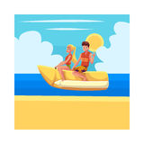 Young couple, man and woman, riding banana boat, water activity Royalty Free Stock Photos