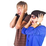 Young couple (man and woman) screaming. Stock Images
