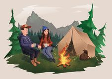 Young couple, man and woman sitting around the campfire in the forest. Hiking, active outdoor recreation. Isolated. Young couple, man and woman sitting around Royalty Free Stock Photo