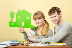 Young couple managing finances. Stock Photos