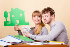 Young couple managing finances. Family future ownership financial bank property home concept. Young couple managing finances. Girl and boy counting money stock photo