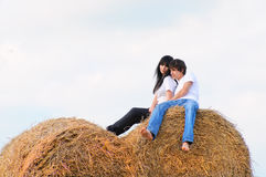 A young couple in the manger Royalty Free Stock Photo