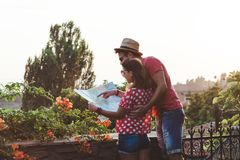Young couple with the map royalty free stock images