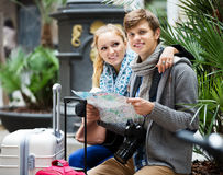Young couple with a map Stock Photography