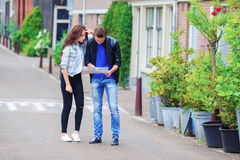 Young couple with a map outdoors Stock Photos