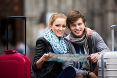 Young couple with a map Royalty Free Stock Photo