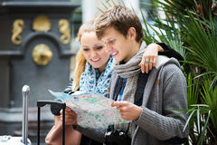 Young couple with a map Stock Image