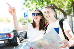Young couple with map Royalty Free Stock Photo