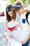 Young couple with map Royalty Free Stock Photos