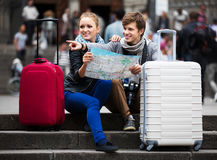 Young couple with a map Stock Images