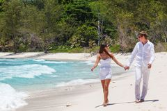 Young couple married laying on sandy beach Stock Photo