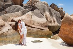 Young couple married laying on sandy beach Royalty Free Stock Image